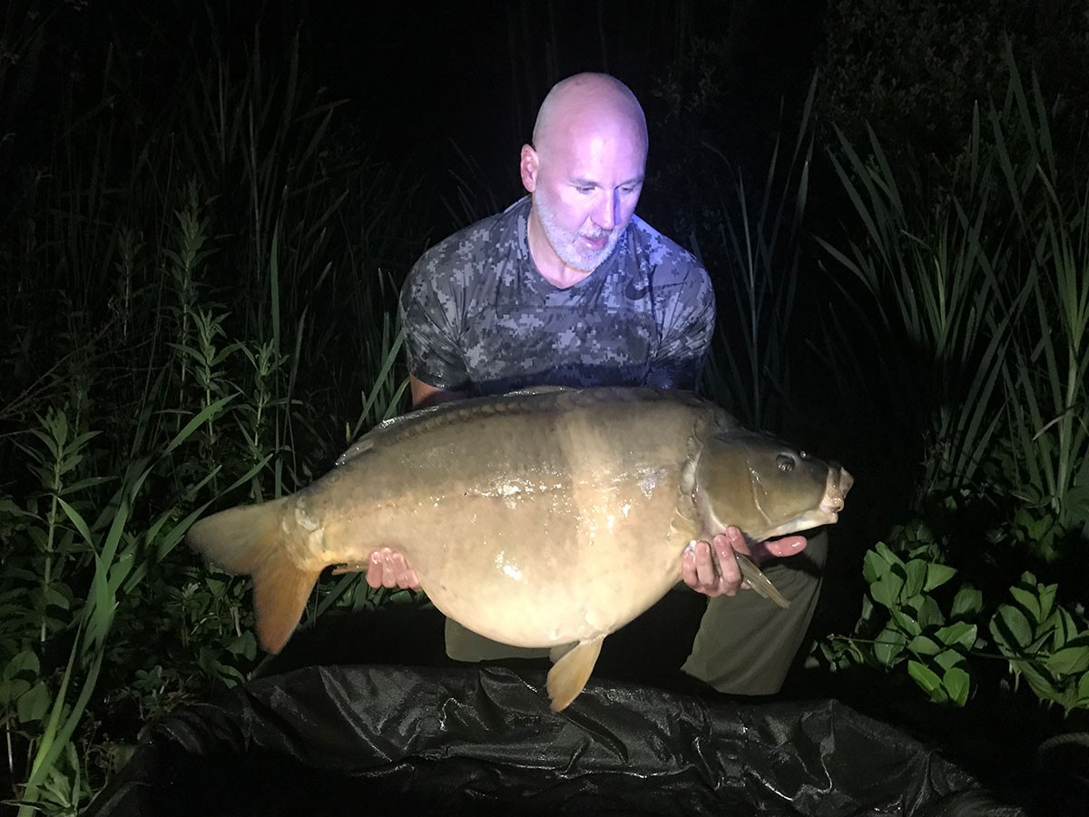 A Cartwright  holding a 48-04 from RH Fisheries