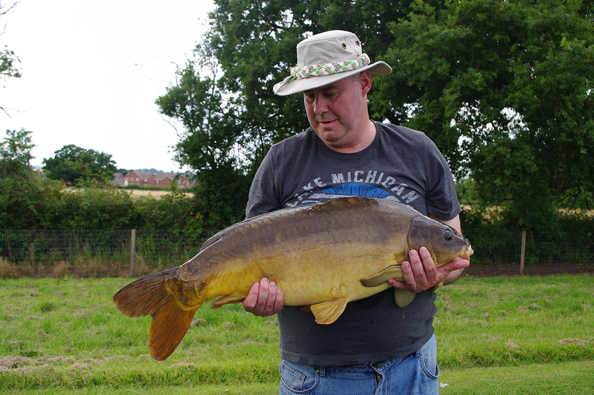 A Lewis holding a 23-00 from RH Fisheries