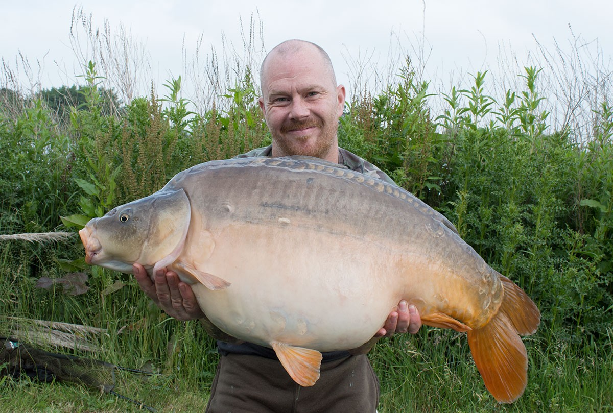 A Odonnell holding a 34-00 from RH Fisheries