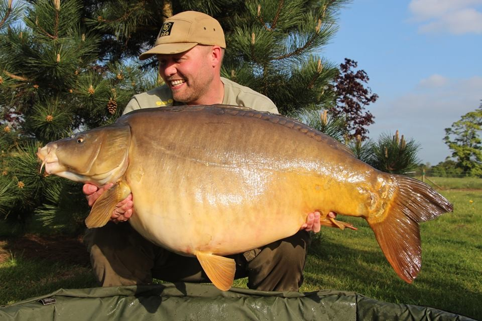 C Sharp holding a 55-07 from RH Fisheries