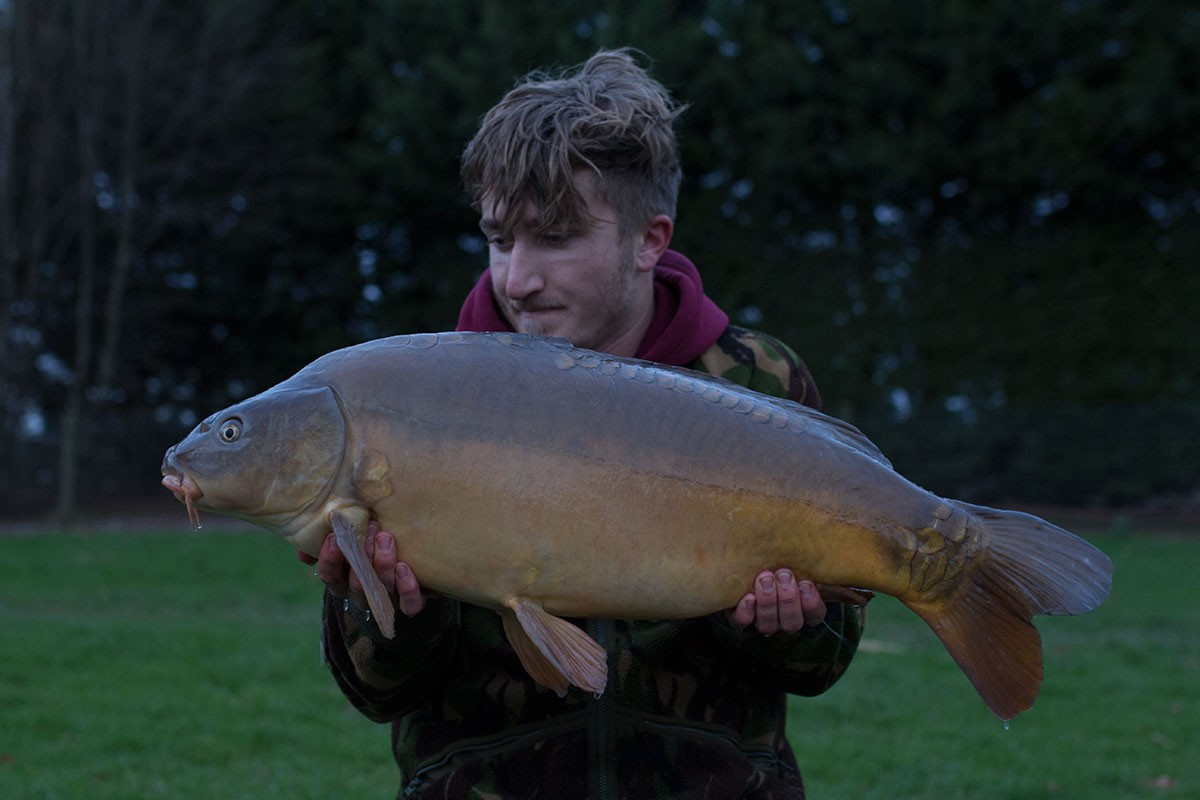 Tom Forrester holding a 25-00 from RH Fisheries