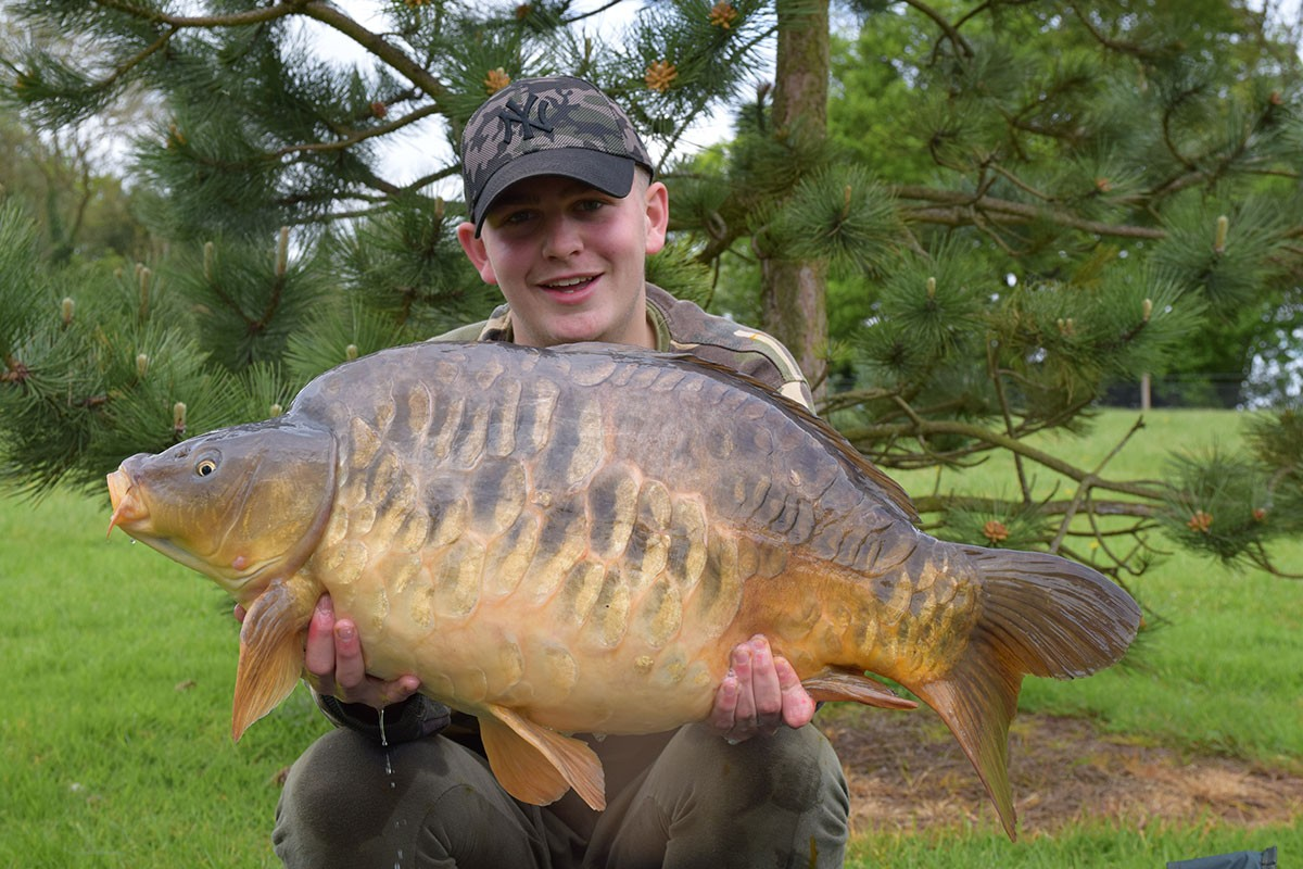 Harry holding a 29-12 from RH Fisheries