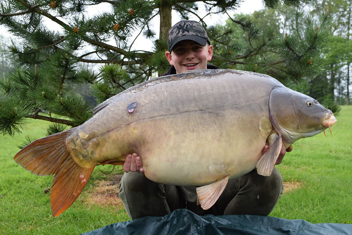 Harry holding a 50-02 from RH Fisheries