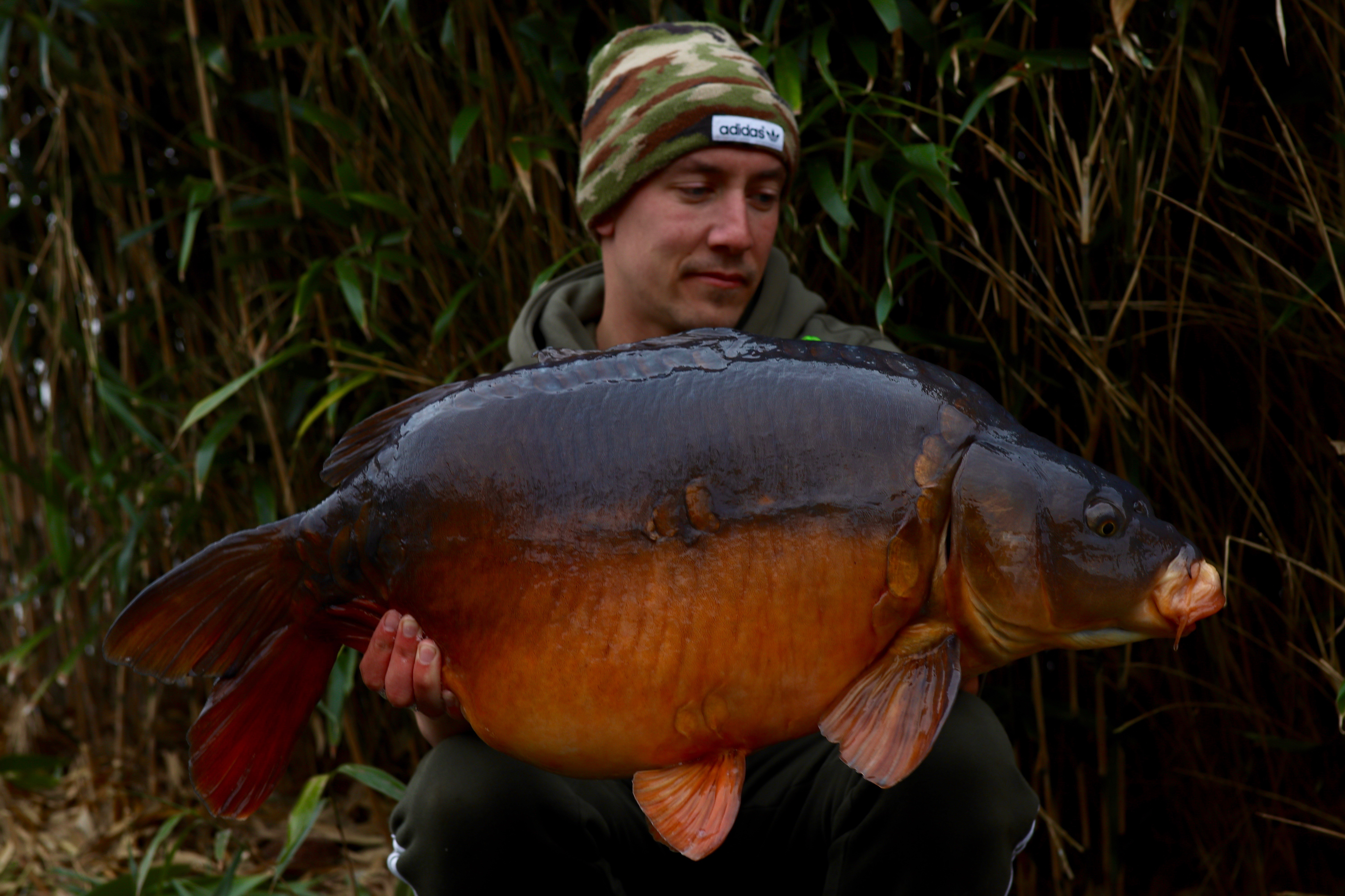 Tom Williams  holding a 27lb 08oz from RH Fisheries