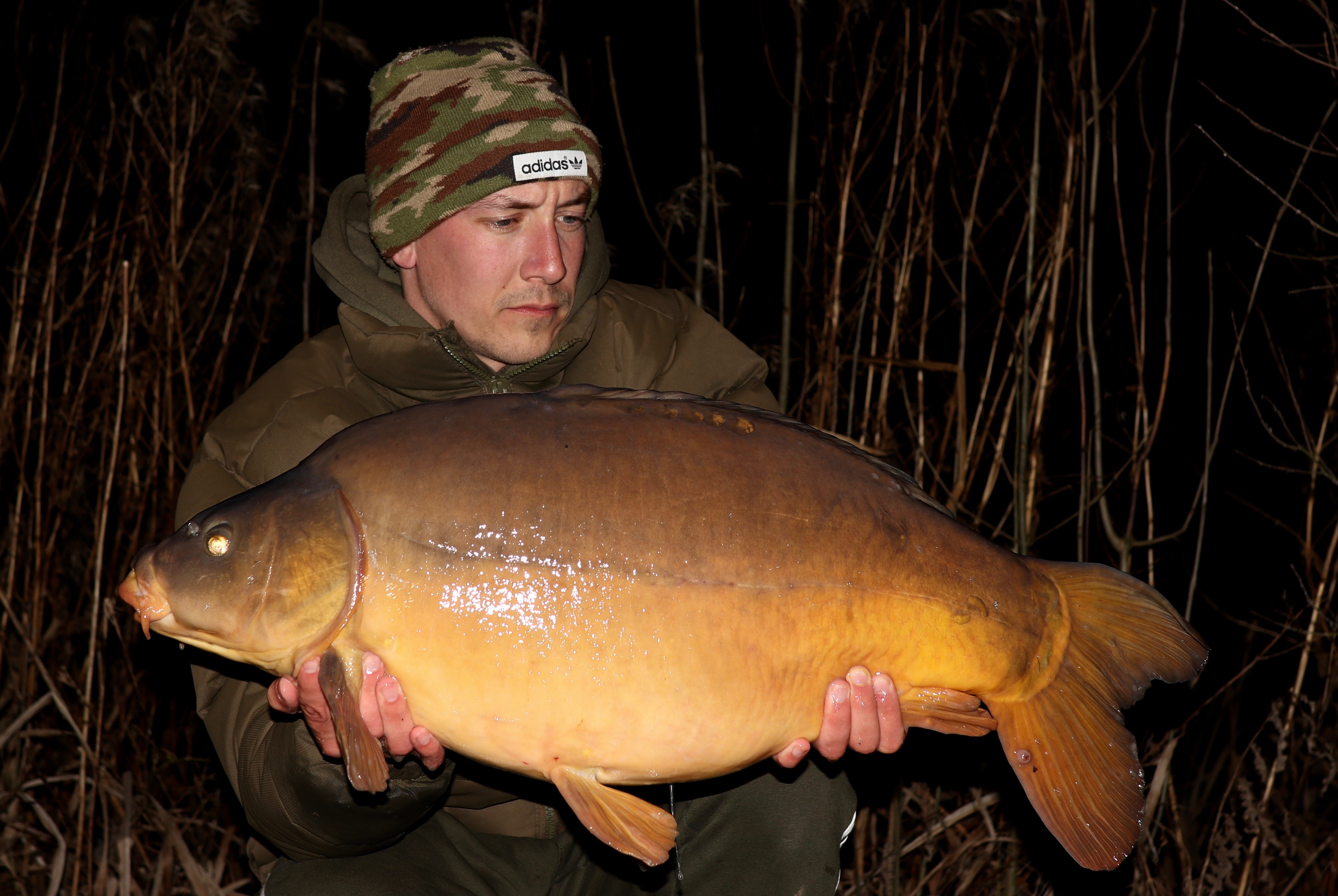 Tom Williams  holding a 26lb 08oz from RH Fisheries