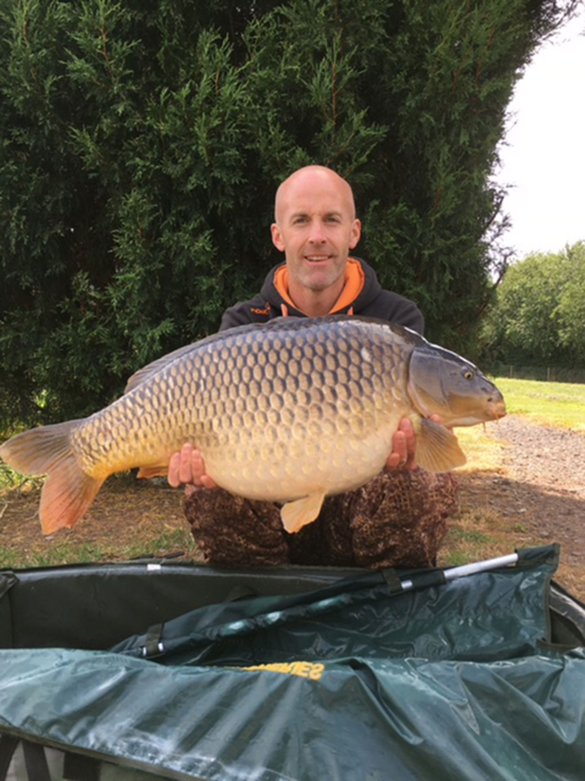 J Whiteman holding a 29-00 from RH Fisheries