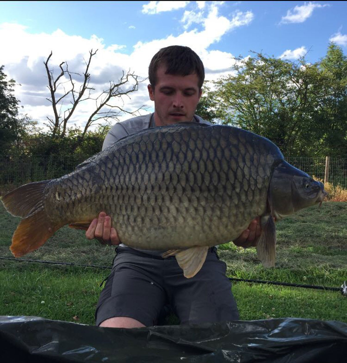M Williams holding a 39-00 from RH Fisheries