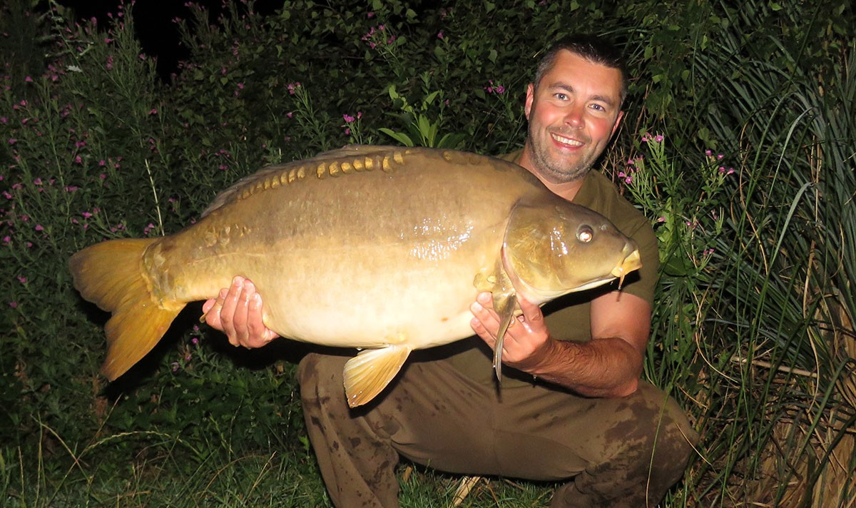 P Lambert holding a 31-06 from RH Fisheries